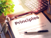 Principles on Clipboard. 3D. Principles on Clipboard with Paper Sheet on Table with Office Supplies Around. 3d Rendering. Blurred Illustration Royalty Free Stock Photography