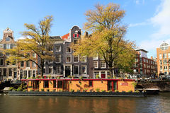 Prinsengracht canal in autumn. Amsterdam, Netherlands. Residential houses along the Prinsengracht canal. Amsterdam, Netherlands Royalty Free Stock Image