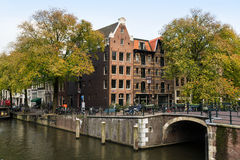 Prinsengracht canal in Fall. Amsterdam, Netherlands. Old apartment house on the intersection of  two canals: Prinsengracht and Brouwersgracht Royalty Free Stock Photos