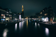 The Prinsengracht canal and Westerkerk at night, in Amsterdam, T Royalty Free Stock Photography