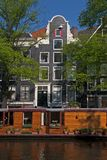 Prinsengracht with houseboat and canal houses Royalty Free Stock Photos