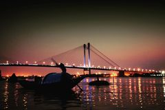 Prinsep Ghat Kolkata. Bridge over Ganges. Sparkling lights and reflections stock image