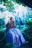 Prinsessa i magisk skog royaltyfria bilder