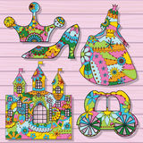 Prinsessagarneringar som är färgrika på träbakgrund Arkivbild