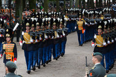Prinsjesdag. THE HAGUE, HOLLAND - SEPT 17: Soldiers accompanying the Golden Coach with Queen Maxima and King Willem-Alexander on Prinsjesdag (opening of Royalty Free Stock Photography