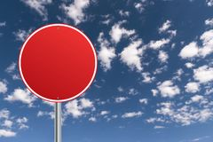 Red traffic sign. Blank red traffic sign against blue skies with white clouds with copyspace stock photos