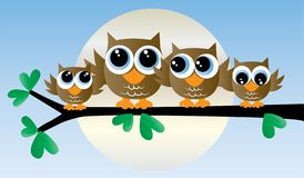 A adorable owl family sitting in a tree stock illustration