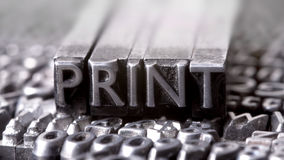 Print. Written with letterpress letters stock photography