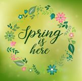 Romantic floral wreath with quote Spring is here stock illustration