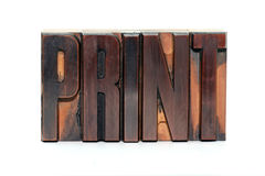 Print. The word Print in old wooden letterpress type - isolated on white background Stock Photography