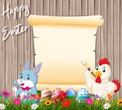 Bunny and rooster painting egg with blank sign background royalty free stock image