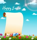Blank paper scroll in the grass field with decorated Easter eggs stock images