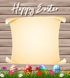 Blank sign in the grass field with decorated Easter eggs royalty free stock photos