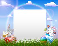 Easter bunny near blank paper and Easter egg royalty free stock images