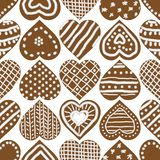 Christmas seamless vector pattern with iced gingerbread heart cookies royalty free illustration
