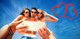 Print against happy friends taking selfie Royalty Free Stock Image