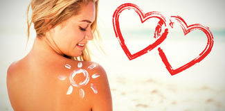 Print against smiling woman with sunscreen on skin Stock Photography