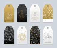 Print for Christmas decorations. Set of New Year and Christmas labels for gifts. Luxury gold color and black with presents and snow for the congratulations Vector Illustration