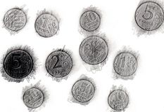 Print of coins a graphite pencil. On a white background Royalty Free Stock Images