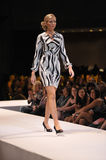 Print dress. Blonde woman wearing a black, grey and white printed dress at the Mercedes-Benz fashion show at the Buffalo NY convention center Royalty Free Stock Photo