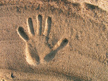 Print of a hand on sand. River sand on coast of the river of Oka royalty free stock images