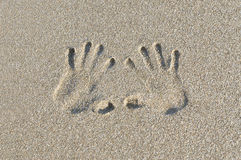 Print of hands. On sea sand Royalty Free Stock Image
