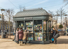 Print kiosk. Moscow, Russia - March 11, 2016: the People who buy Newspapers at a kiosk periodicals near the metro station Paveletskaya Royalty Free Stock Image