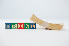 Print letter blocks with book on white background Stock Image