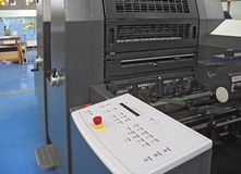 Print machine. Offset print machine in printing firm Royalty Free Stock Photo