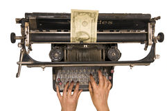 We print money. Female hands print dollar denomination on old typewriter stock images