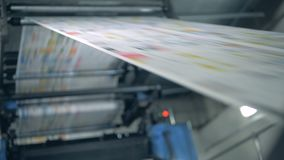 Print office equipment working with newspaper sheets, automated technology. 4K stock video footage