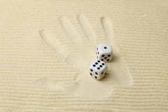 Print of a palm with dices lying on it Stock Images