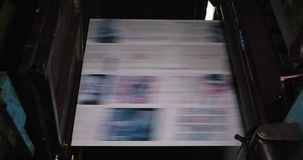 Print plant factory. Newspaper printing at a plant. Newspaper printed on a printing house machine stock video