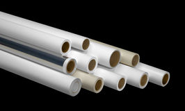 Print rolls for wide-format printers. Various print media rolls for wide-format printers in black back stock photography