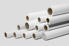 Print rolls for wide-format printers. Various print media rolls for wide-format printers in light grey back stock images