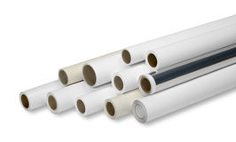 Print rolls for wide-format printers. Various print media rolls for wide-format printers in white back stock photos