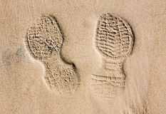 Print of a shoe in desert sand Stock Photography