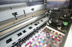 Print shop, inside large format ink jet printer stock image