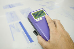 Print shop, Platereader instrument with halftone measurement and control Stock Image