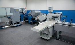 Print shop (press printing) - Finishing line Royalty Free Stock Photography