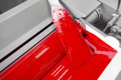 Print shop red magenda color ink roller Stock Image