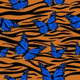 Print tiger skins combined with monarch butterflies. Seamless vector pattern stock illustration