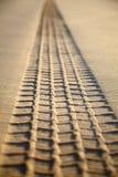 Print of a tyre tread on a sand Stock Photos
