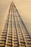 Print of wheel tread on a sand Stock Photo