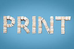 PRINT word arranged from books. PRINT word formed from books, shot from above on light blue background Royalty Free Stock Photography
