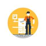 Print worker in uniform with printer Stock Photography