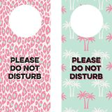 Printable Doorknob Hangers. Two Door Knob Tags that read Please do not disturb and have animal print and retro patterns Royalty Free Stock Photos