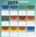 Printable monthly calendar 2017 design. With colors of seasons and henna tattoo. 2017 Desk calendar template start with Sunday and support for 8.5x11 inches Stock Images