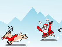 PrintAngry santa with playful reindeer Royalty Free Stock Photo
