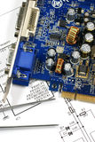 Printed circuit board. Electronic scheme and tweezers Royalty Free Stock Photo